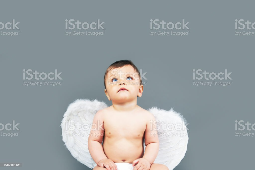 Little angel baby boy stock photo