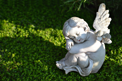 Little angel figurine on the grave