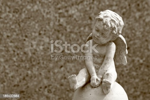 istock little angel statue and space for text 185432584