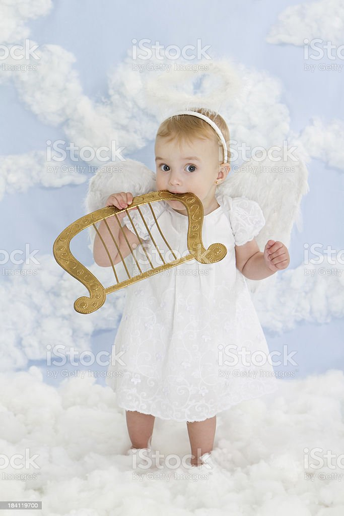 Little angel with harp royalty-free stock photo