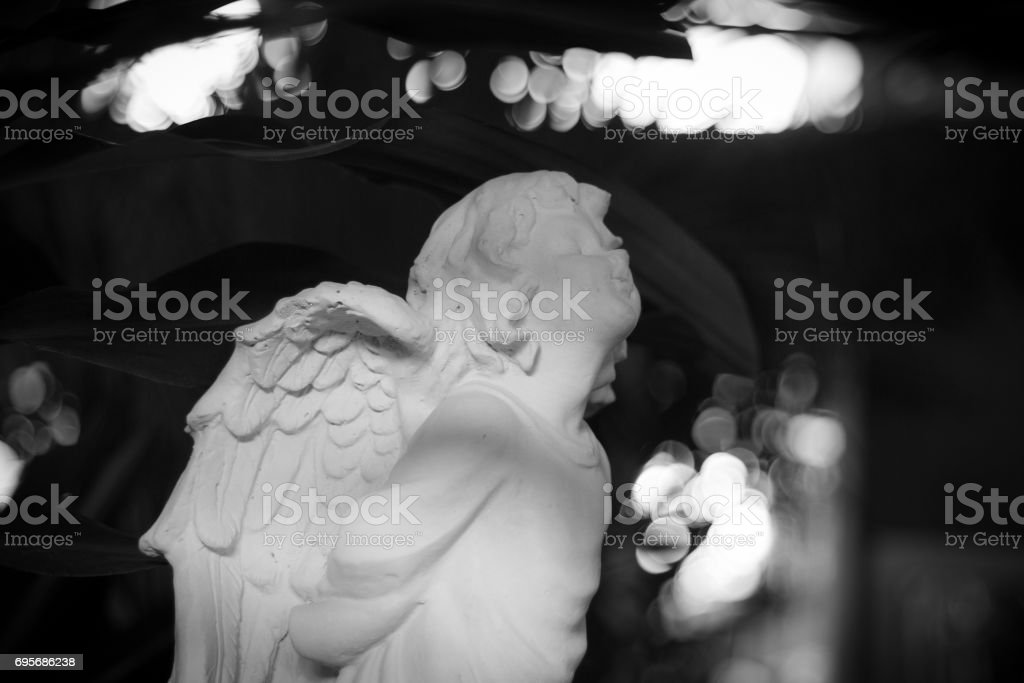 Little angle statue in black and white color. stock photo