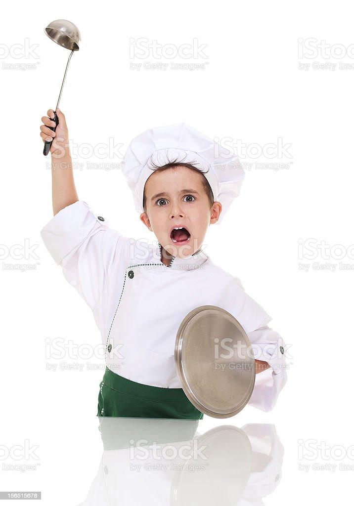 Little angry Jungen Koch bringt mit Küchenzubehör – Foto
