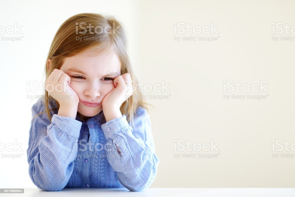 Little angry or bored girl portrait stock photo