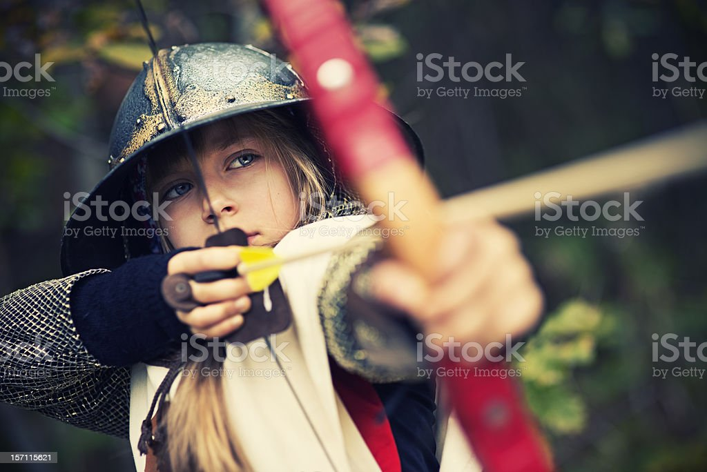 Little archer in woods stock photo