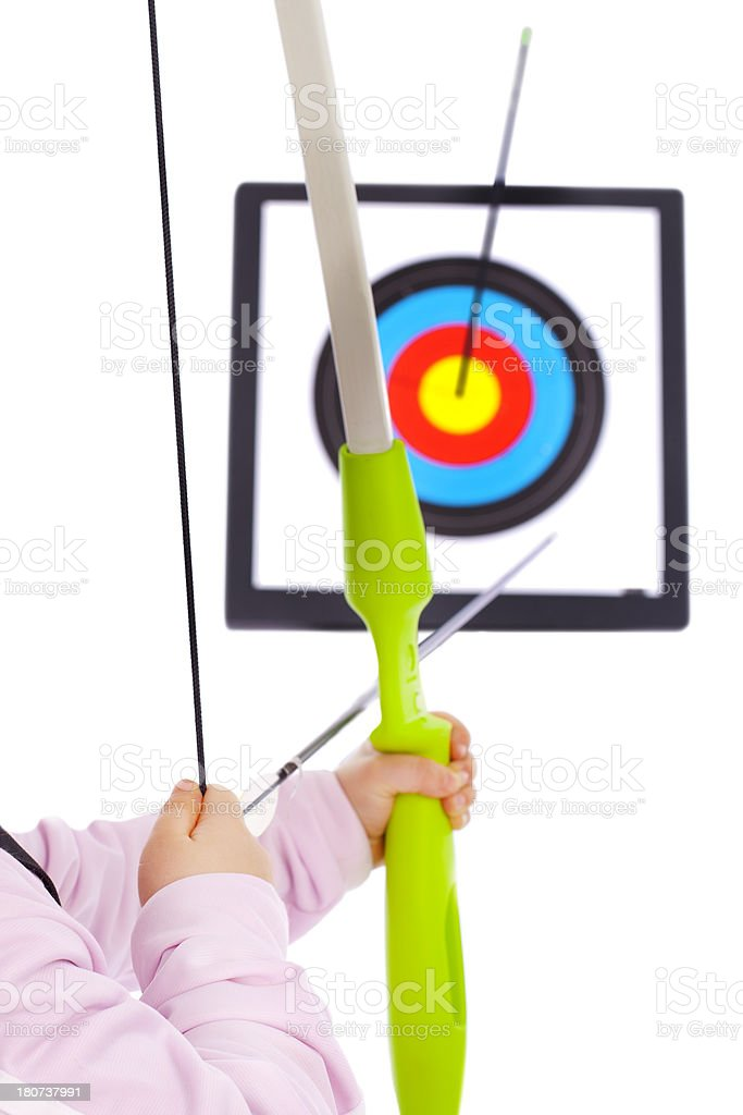Little Archery girl's hand in front of the Target royalty-free stock photo