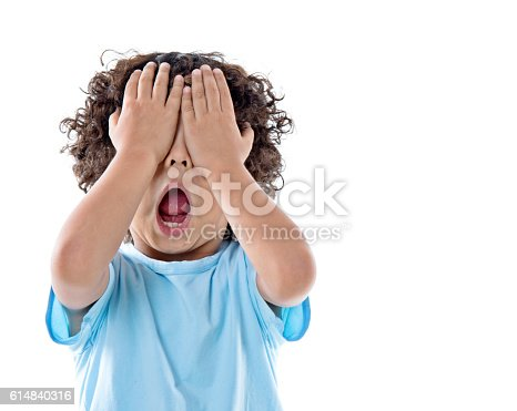 istock Little asian boy covering eyes against white background 614840316