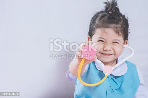 istock Little Asian Girl and Stethoscope toy with Doctor concept copy space. 802967074