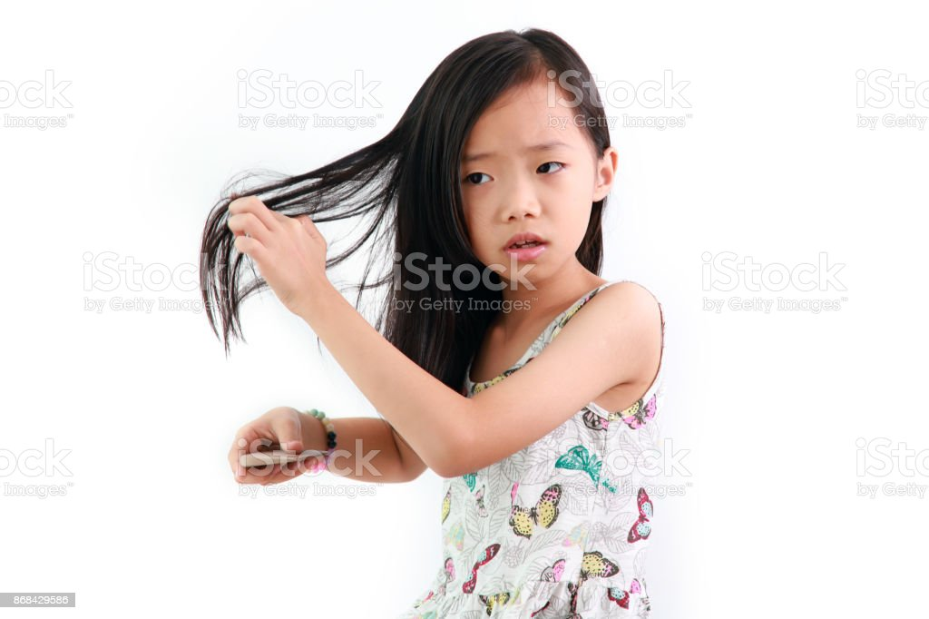 Little Asian Girl Combing Her Hair Royalty Free Stock Photo