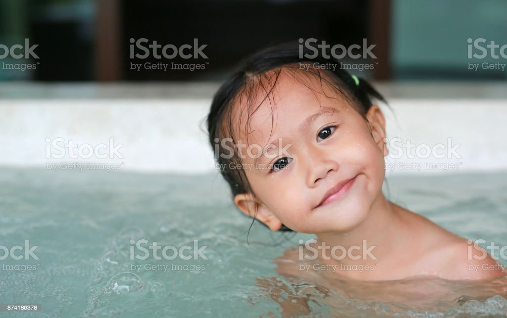 Magic Bath Baby Jacuzzi.Little Asian Girl Playing In Hot Tub Hot Tub Stock Photo