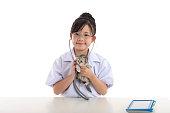 istock Little asian girl playing veterinarian with kitten 480599488