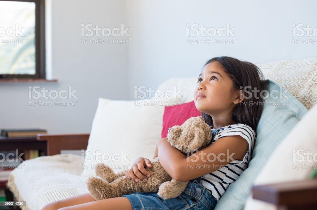 Little asian girl thinking stock photo