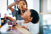 Eating, Baby - Human Age, Messy, Toddler, Pasta, Asian and Indian Ethnicities, Chinese Ethnicity, Girls, Shanghai