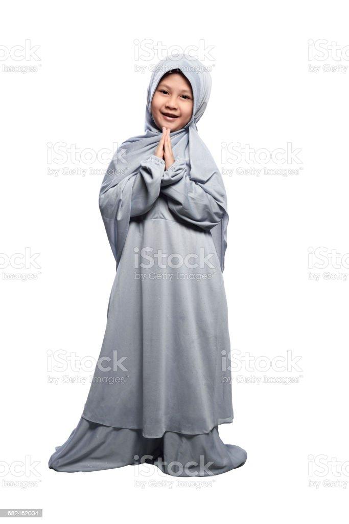 Little asian muslim girl wearing hijab praying royalty-free stock photo