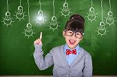 Little Asian teacher showing school education concept
