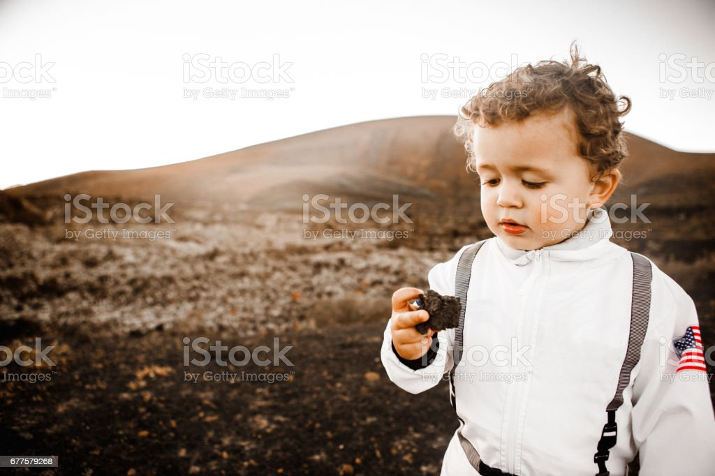 Little astronaut in the moon royalty-free stock photo