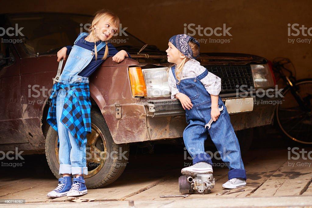 Little auto mechanics stock photo