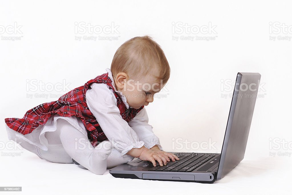 Little baby and laptop royalty-free stock photo