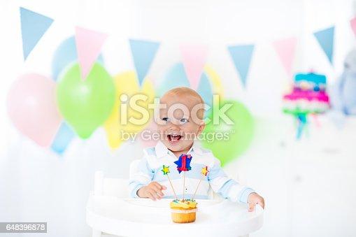 istock Little baby boy celebrating first birthday 648396878