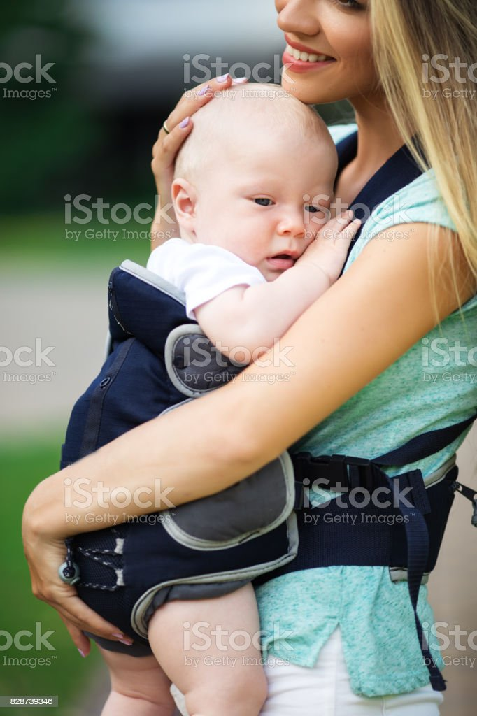 9951b454daa Little Baby Boy In Sling With Happy Mother Stock Photo   More ...