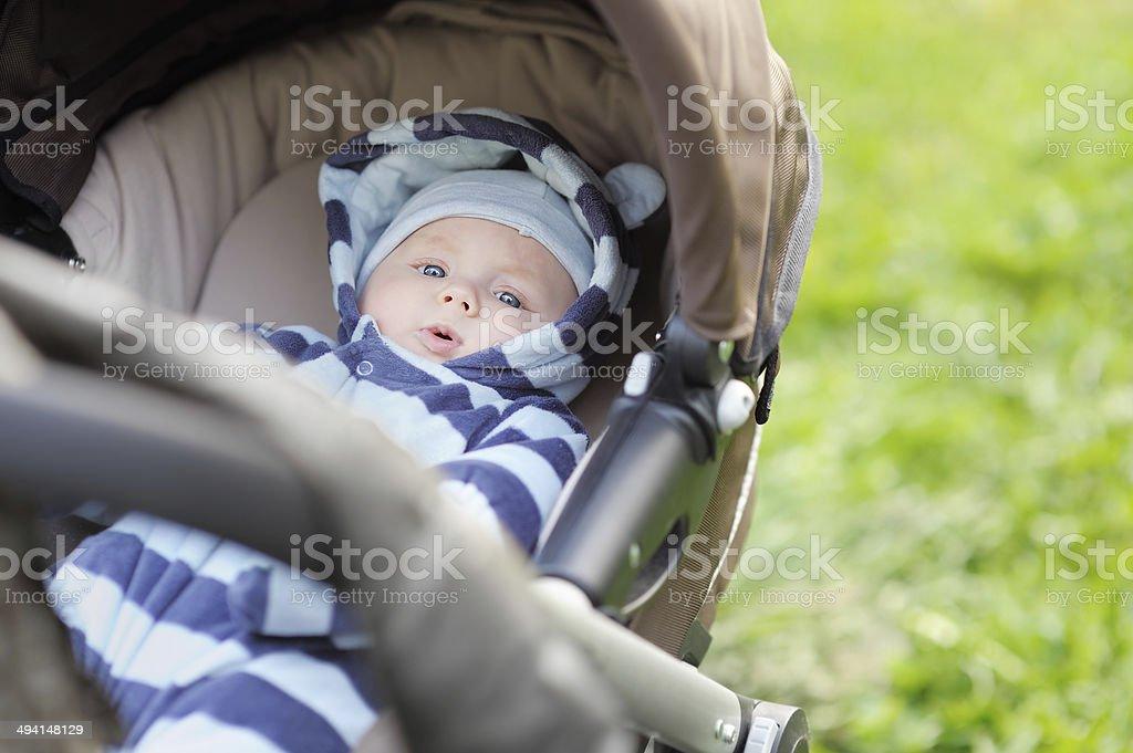 Little baby boy in stroller stock photo