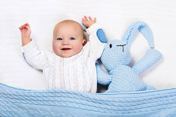 Little baby boy playing with blue knitted bunny toy picture id618627278?b=1&k=6&m=618627278&s=612x612&w=0&h=yyfdjo  qfl 9otppu ovnzprbt4qbkja fw4xuasp8=