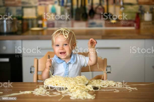 Little baby boy toddler child eating spaghetti for lunch and making a picture id986536600?b=1&k=6&m=986536600&s=612x612&h=1j k3oqqpbfrbaobpx13xpvrrskzozyqw9pnq3k7aca=