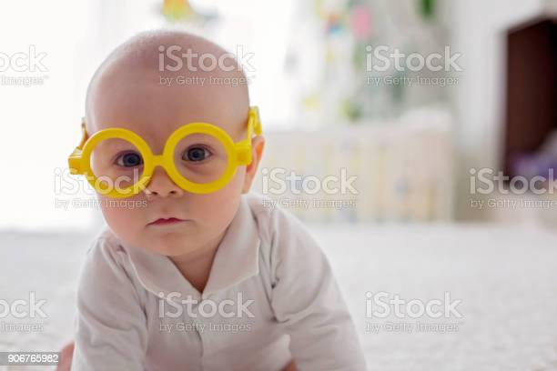 Little baby boy toddler playing at home with funny eye glasses in bed picture id906765982?b=1&k=6&m=906765982&s=612x612&h=gkmlbc0drwgts2nwrfefu7hduxucsnvzetonlvfdpau=