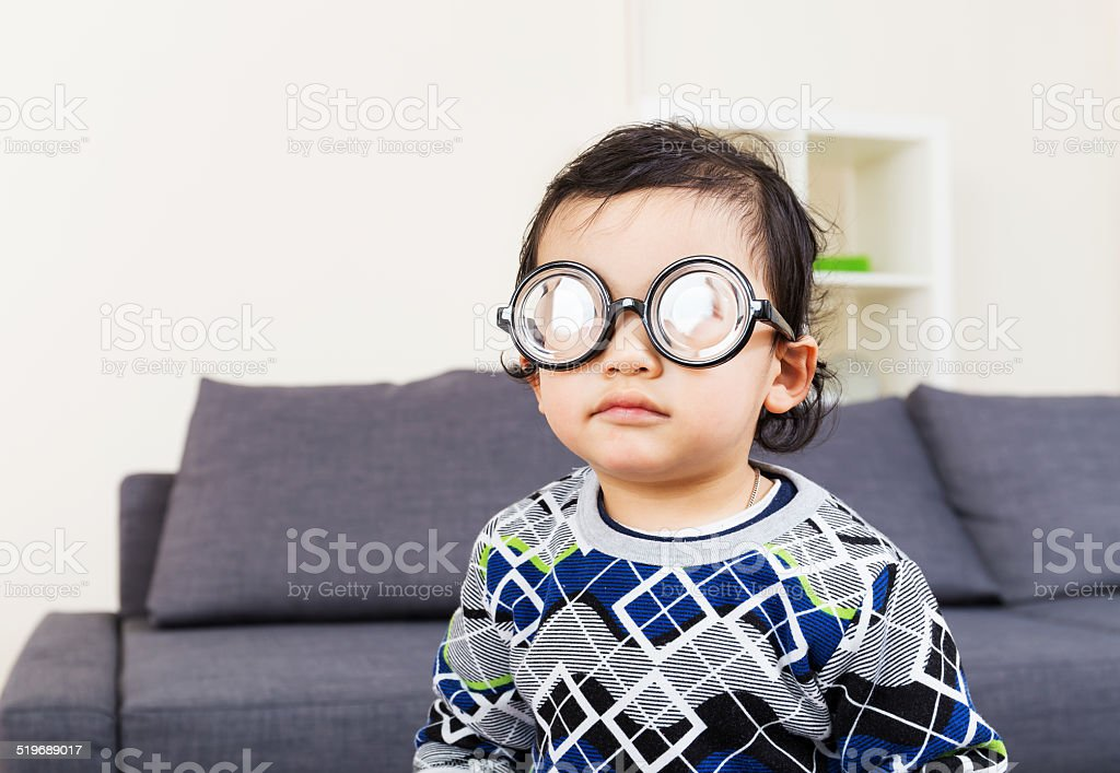 Little baby boy wear thick glasses stock photo