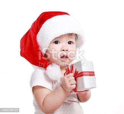 istock Little baby celebrates Christmas. New Year's holidays. 543205722