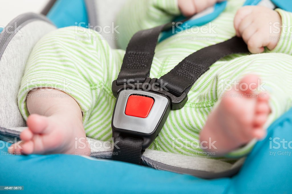 Little baby child in safety car seat stock photo
