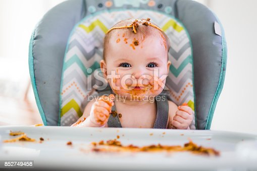 istock Little baby eating her dinner and making a mess 852749458