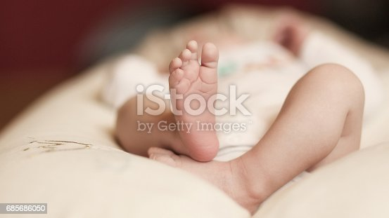 Little baby feet with blurred background