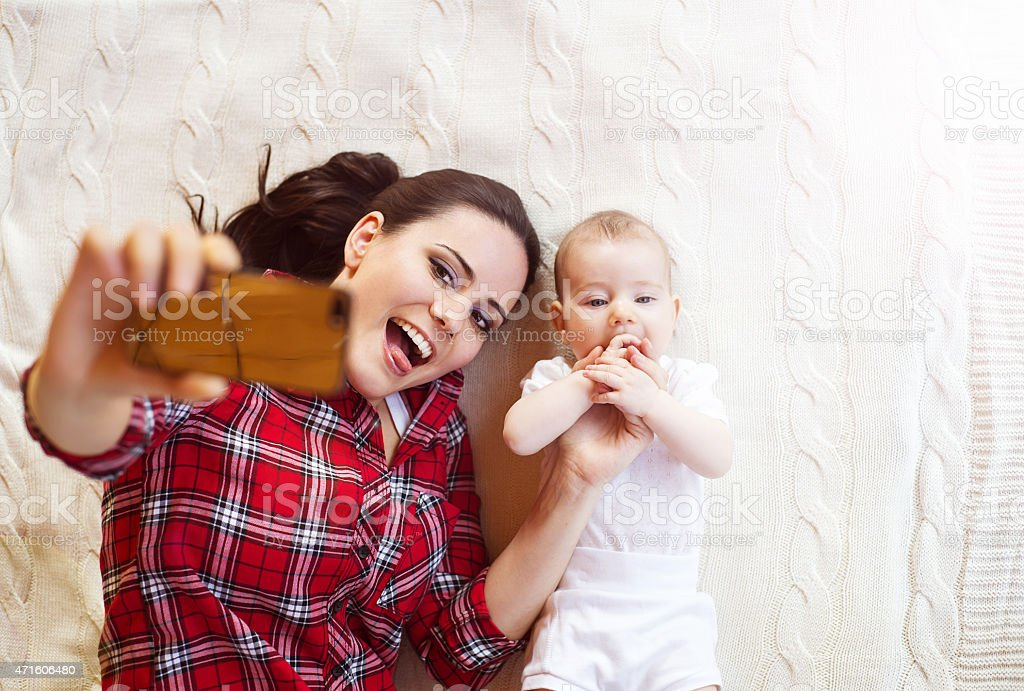Little baby girl and her mother stock photo