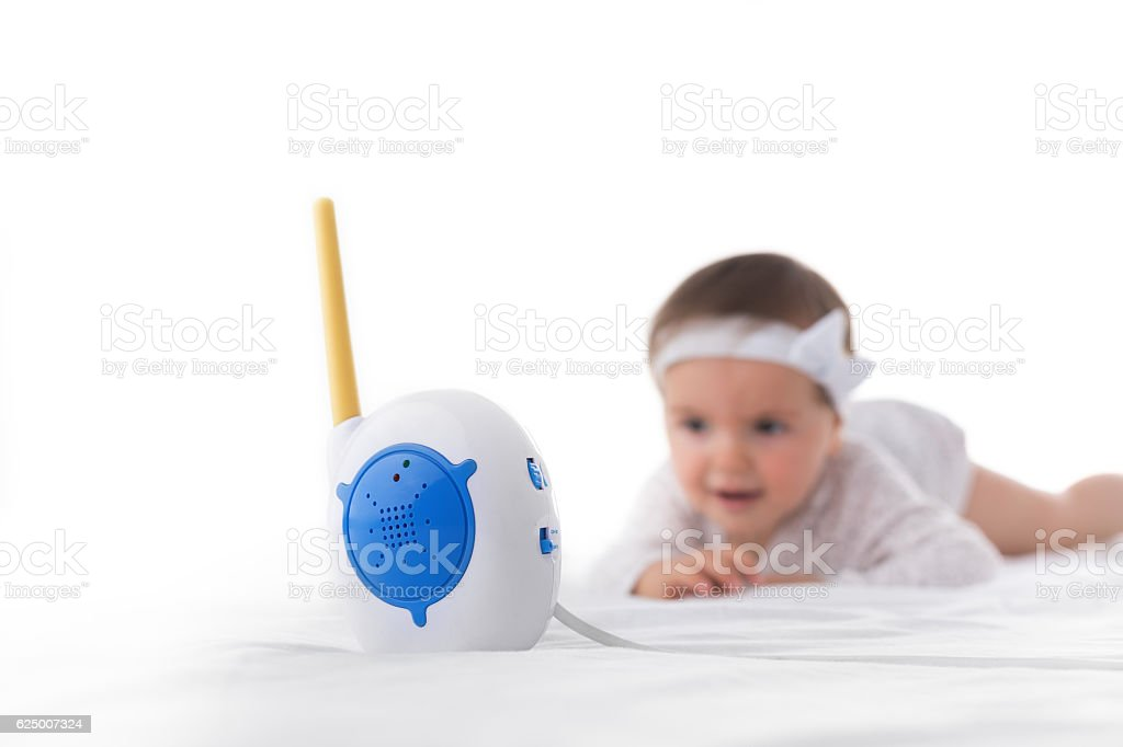 Little baby girl and monitor isolated on white stock photo