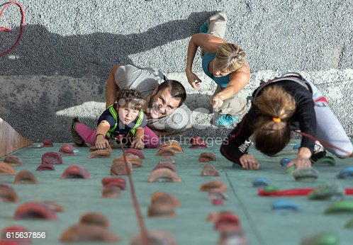 istock Little baby girl doing first steps on climbing wall 615637856