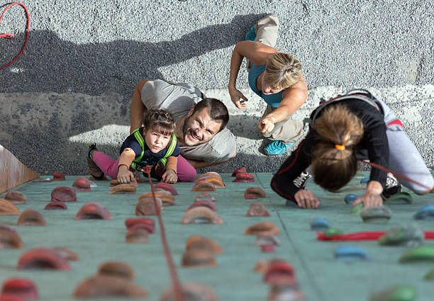 Little baby girl doing first steps on climbing wall – Foto
