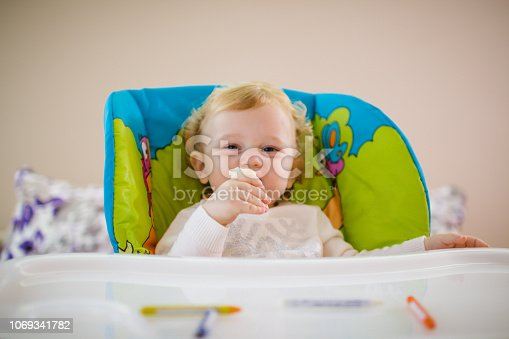 Little baby girl eating banana