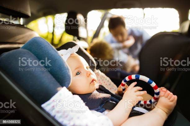 Little baby girl fastened with security belt in safety car seat picture id864569320?b=1&k=6&m=864569320&s=612x612&h=0msdlngduzghjnbs4hpb4jtbzyhqdnp5chofyr6xd0q=