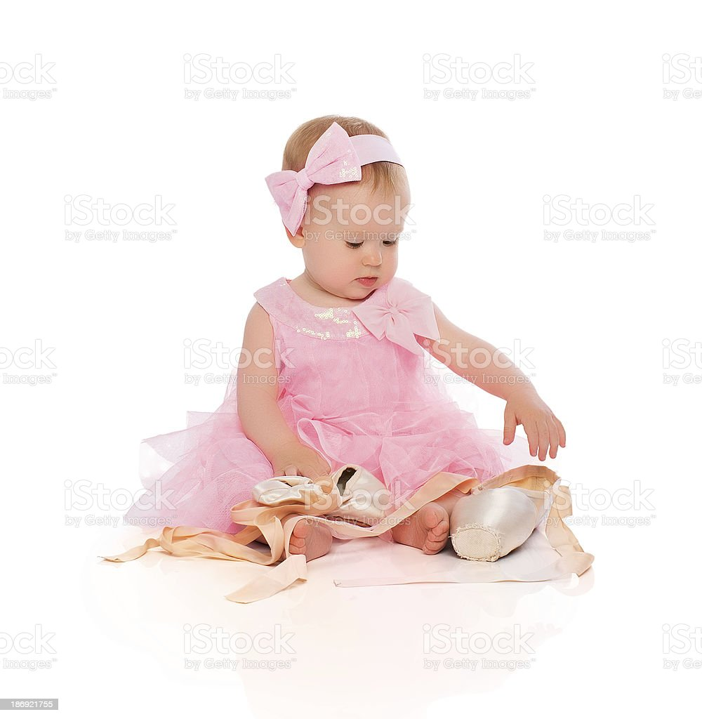 51c39afb8c81 Little baby girl in pink ballerina dress with pointe shoes - Stock image .