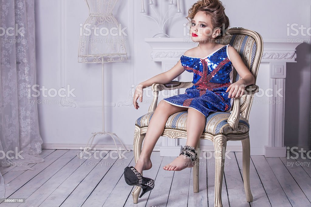 Little baby girl in the image of a glamorous model stock photo