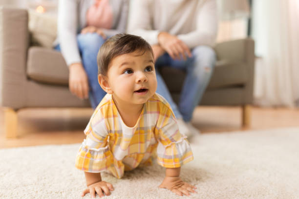 little baby girl on floor at home stock photo