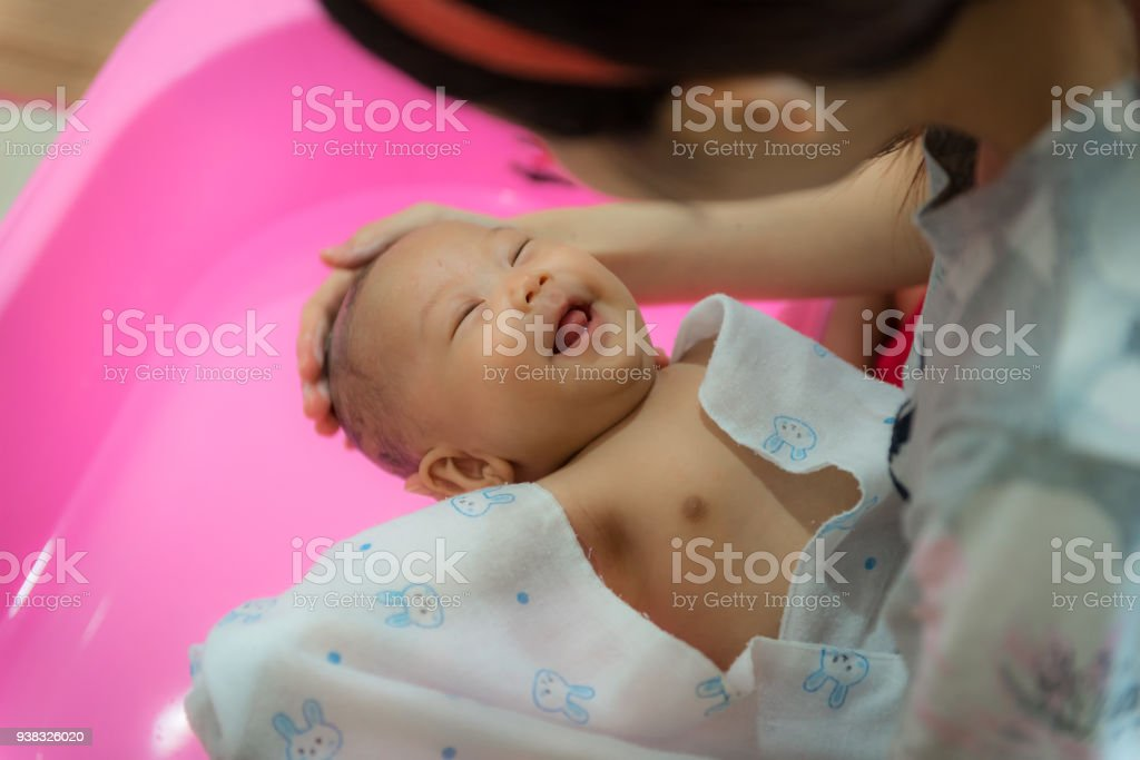 Little Baby Having Fun While Mother Bathing For Her In Plastic Bath ...