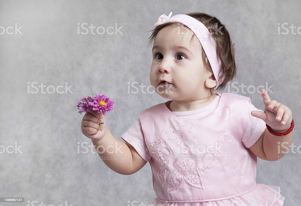 Little baby hold flower royalty-free stock photo