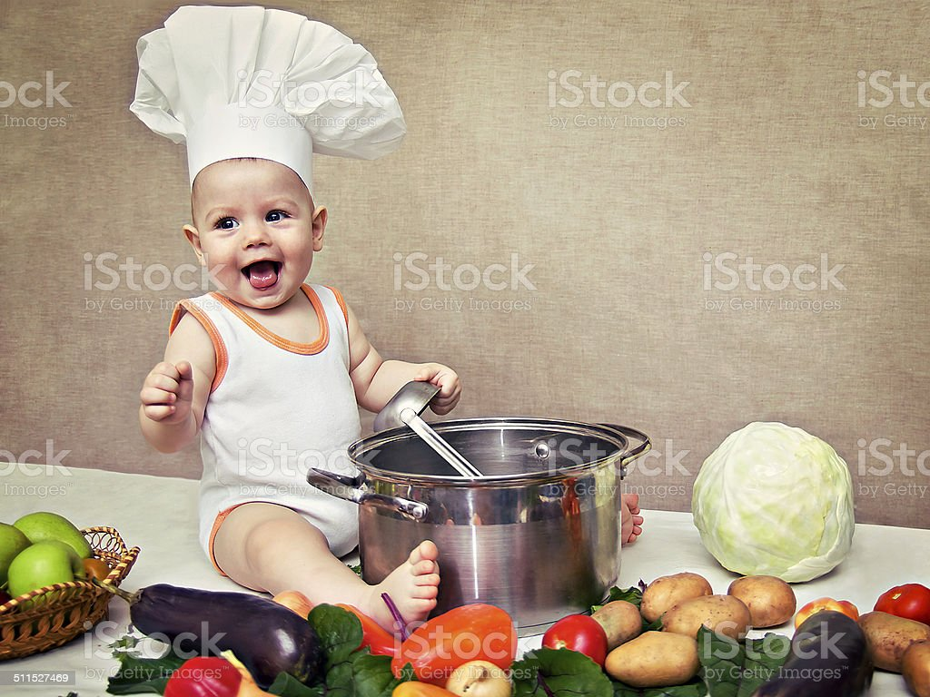 little baby in a chef's hat and ladle in hand stock photo