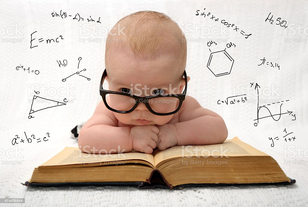 little baby in glasses with eauations around stock photo