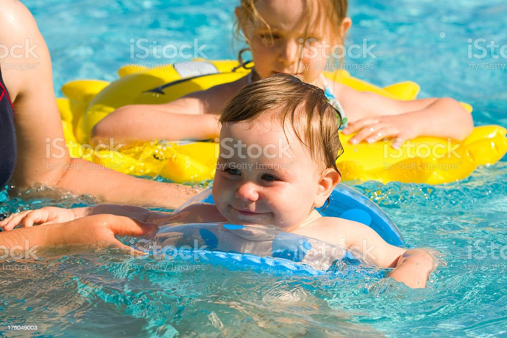 Little baby in pool royalty-free stock photo