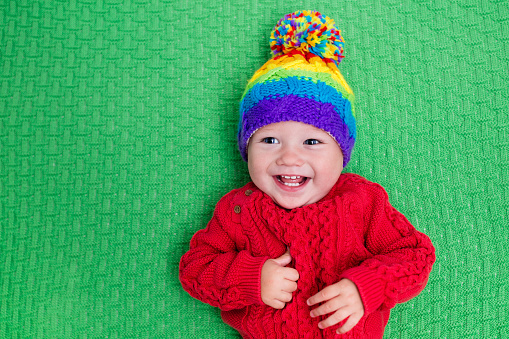 Little baby in warm wool knitted hat