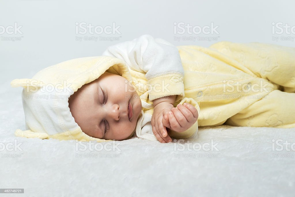 Little baby is sleeping  on the carpet royalty-free stock photo
