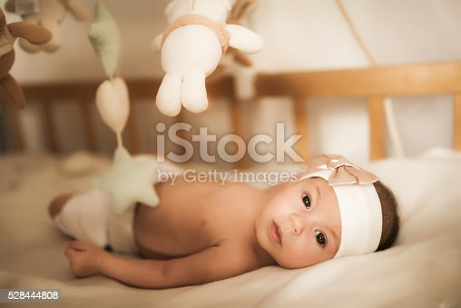 istock Little baby on sheet in bed room 528444808