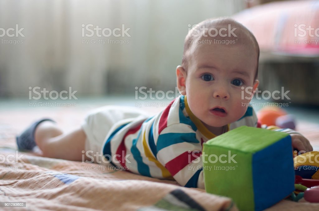 Little baby play with toys on the floor stock photo